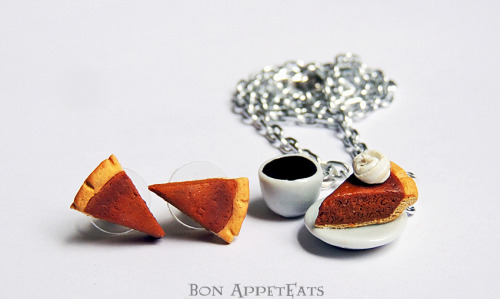 bon-appeteats:  So I finally got around to making a pumpkin pie. Not too bad for the first one, but it needs a bit more translucency and I'll be happy. This is a necklace with a cup of coffee and a slice of pumpkin pie with whipped cream, along with pumpkin pie slice post earrings.These aren't going in my shops just yet (since I plan on taking them to the craft show), but if you'd like a pair, just send contact me. :)