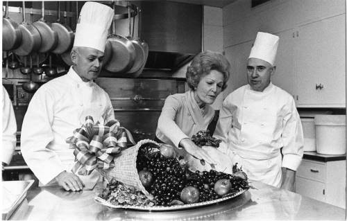 Pat Nixon with the White House Chefs in the kitchen, viewing the Thanksgiving turkey and vegetables.  November, 19, 1970. -from the Nixon Library