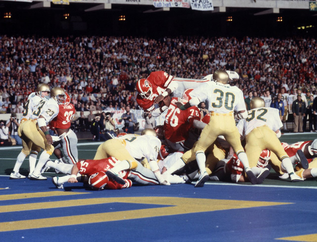 Georgia RB Herschel Walker jumps over a pile of Notre Dame defenders during the 1981 Sugar Bowl. Walker was named the game's MVP after scoring two touchdowns in a 17-10 victory. (Heinz Kluetmeier/SI) GALLERY: Rare Photos of Herschel Walker