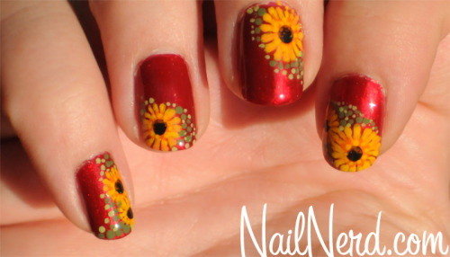 Daisies done with dotting tools on a base of OPI Danke-Shiny Red