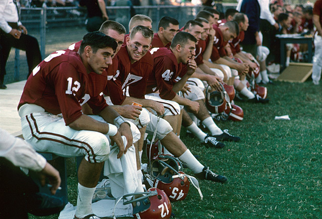 Alabama quarterback Joe Namath (12) and his teammates sit on the bench during a 1962 game against Tennessee at Neyland Stadium. (Neil Leifer/SI) GALLERY: Classic Photos of Joe Namath