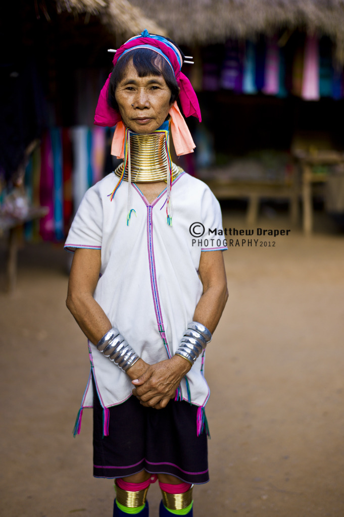 A Kayan lady in Northern Thailand. Kayan girls first don the rings when they are around five years old. As the girls grow older the coils are replaced with larger ones, with more turns gradually added. The weight of the brass pushes the collarbone down and compresses the rib cage. The neck itself is not lengthened: the appearance of a stretched neck is instead created by the deformation of the clavicle. WATERMARK POSITION NECESSARY DUE TO UNAUTHORISED PHOTO SHARING