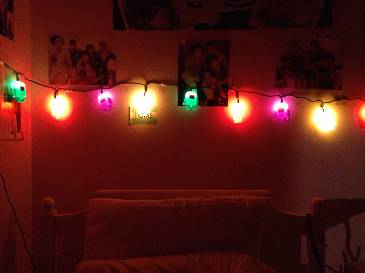 Finally strung my lights! I know you can't tell but they're mini domos and they're so long they go around like my entire room c: