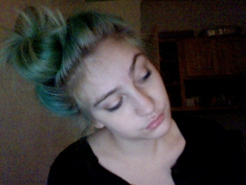 I woke up with this bun on my head.  Time to go to work, then to skip school to grocery shop for tomorrow with my sister.