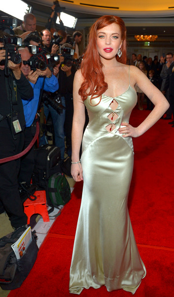 Lindsay Lohan kick starts her comeback attempt by transforming herself into Little Mermaid Ariel after she gets, what do you call 'em? Oh, feet. Somehow, we think it works.