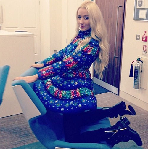 Iggy wearing a Jeremy Scott x Adidas coat.