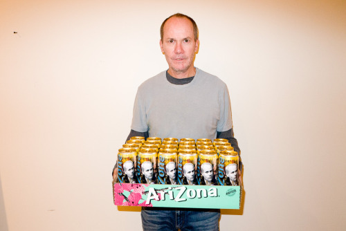 Richard Prince holding a case of his new Lemon Fizz Arizona drink.