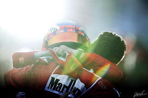 #Title Deciders 2003 title decider. Schumacher had moved his lead to 9 points following victory at the previous grand prix in the US, but Raikkonen out qualified his rival by 6 positions but still only eight. The McLaren of Raikkonen was supposed to be a transitional car but was more consistent, reliable and most important faster than the planned MP4-18. The Ferrari of Schumacher was the fastest, but not as fast as it had been in years prior. Schumacher had to work for this title and from down the grid. Montoya took the lead from pole sitter Barrichello but then his car gave way. Barrichello sat about doing his all to protect the lead from the resurgent Raikkonen and team mate Coulthard who, a dual-retirement from Ferrari willing, could together clinch the driver's and constructor's titles for McLaren. Schumacher slowly picked off driver after driver, but on lap six tangled with Takuma Sato, losing his wing. The title was in Ruben's hands, but Raikkonen and Coulthard kept up the pressure albeit from a distance. Schumacher slowly built up his way to the point he needed to but with ten laps remaining had to avoid an incident and gave himself a set of flat spots. He feared the suspension would give way, the vibrations so bad he could barely see in front of him, but he made his way home taking the solitary point that would clinch victory, even if his team mate had given up the lead to Raikkonen. Which he didn't. The young Finn would have to wait four more seasons for his first title, in the most dramatic of circumstances. Schumacher would not even have to wait 12 months for his seventh. As for the photo:  Sometimes, luck comes to the rescue… When Rubens Barrichello came out of his car after winning tne 2003 Japanese GP in Suzuka, he fell into the arms of Michael Schumacher, who had finished only eighth, but was World Champion for the sixth time! Standing at a distance, with a 600 mm lens, in very low light conditions, it looked like pretty grim, and then someone fired off his flash behind the drivers, just as the shutter was being released for 1/250th of a second… Magic.