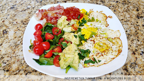 Breakfast: 3 fried eggs, bacon, avocado, tomatoes, spinach, thyme, parsley, salsa. First time trying my eggs like this. Not too bad :)