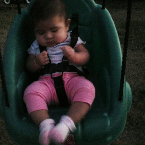 My babys first time on a swing. She loved it (: