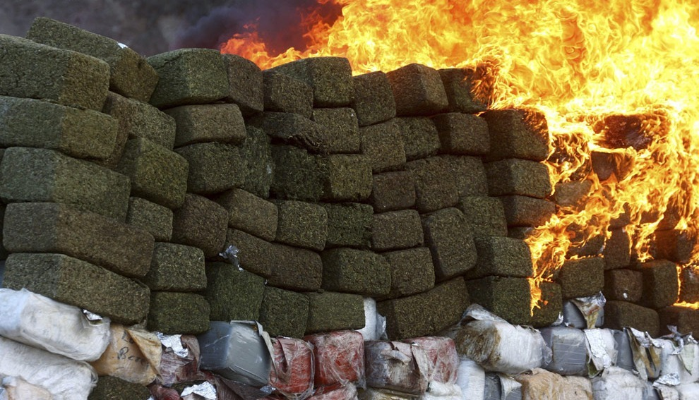 Tonnes of marijuana are being incinerated at the military base Morelos in Tijuana October 20, 2010. Soldiers seized 134 tonnes of marijuana on Monday in Mexico's biggest-ever pot haul, the army said. Heavily armed soldiers raided a series of homes in a poor suburb of Tijuana, across the border from San Diego, California, and came under fire at least once as they took the drugs, also arresting 11 suspected traffickers.