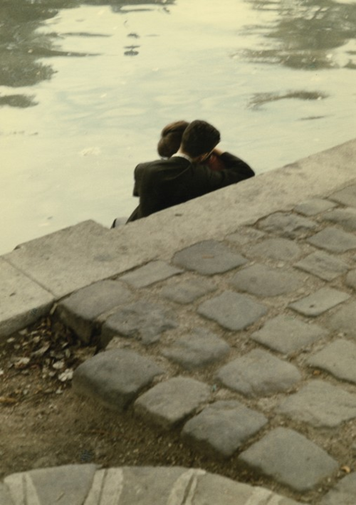 Lovers on the banks of the River Seine near the Square du Vert-Galant, Ile de la Cité, Peter Cornelius by Peter Cornelius