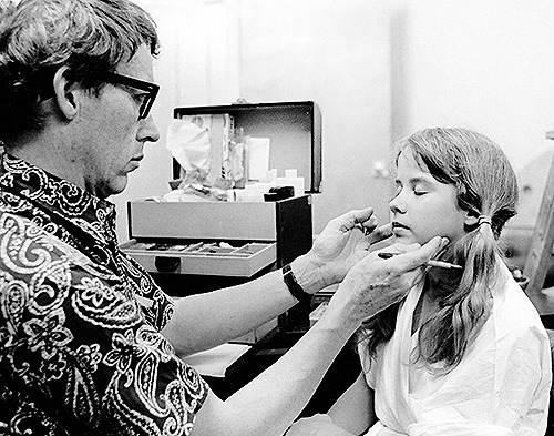 Dick Smith retouches Linda Blair's make-up on the set of The Exorcist.