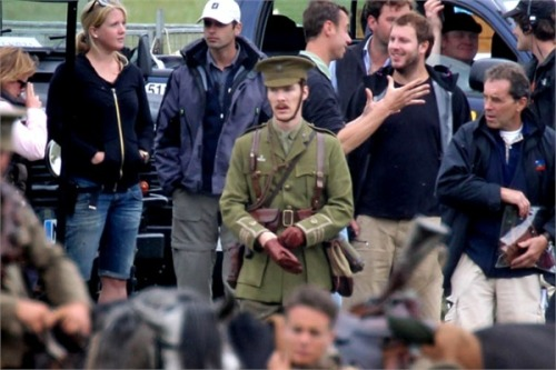 wandasweet:  poor dear @_@ War Horse movie set  He really looks like a figure from another time among all those casually dressed people. :)