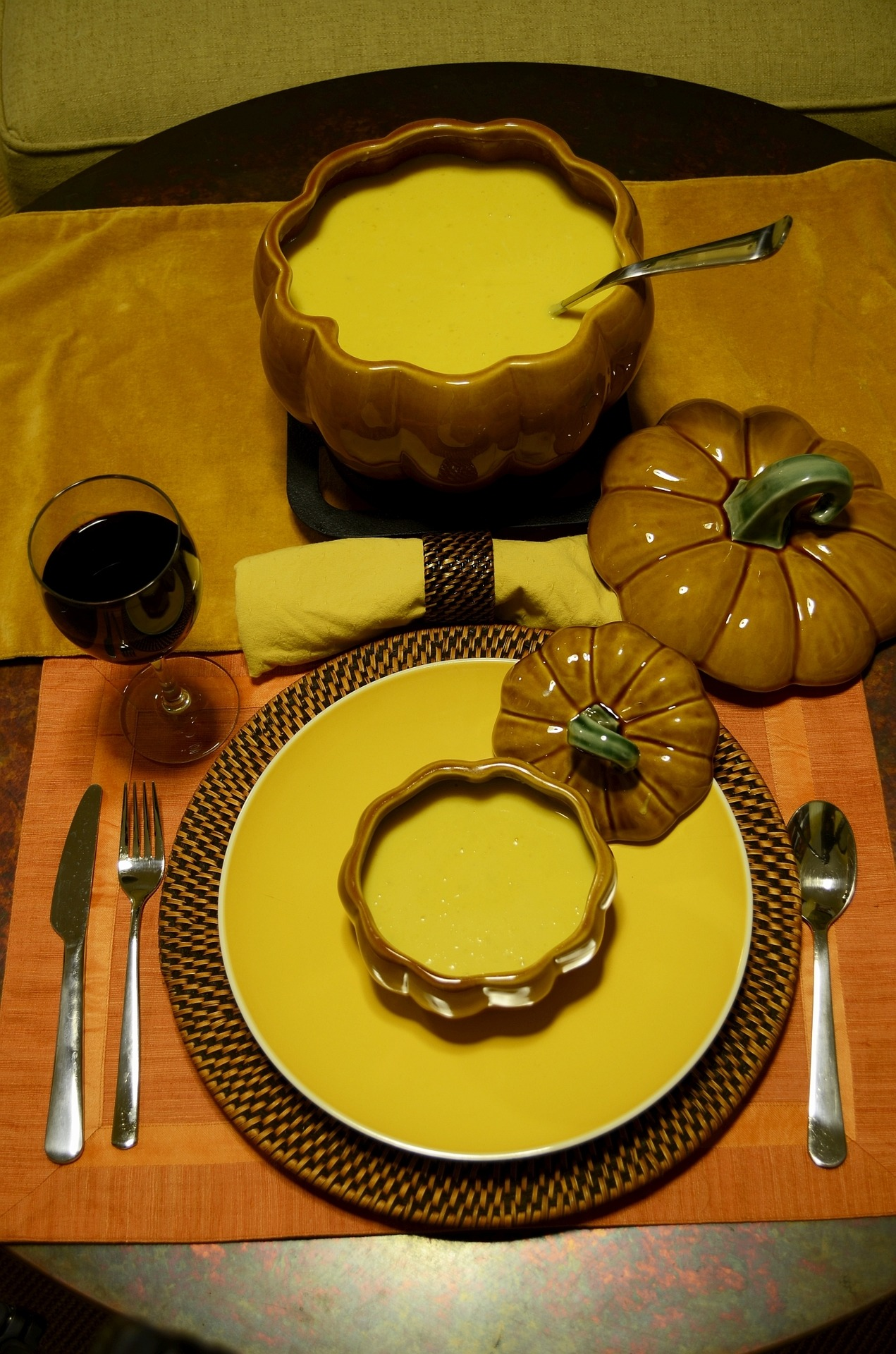 pumpkin soup served in pumpkin tureen and pumpkin bowl