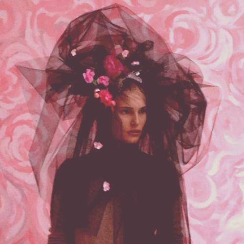 Model Alla Kostromichova in Piers Atkinson's black veil head dress