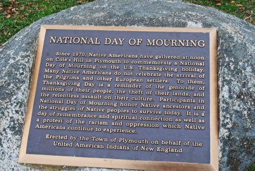 """National Day of Mourning"" plaque at the site of the historical monument Plymouth Rock in Massachusetts. United American Indians of New England"
