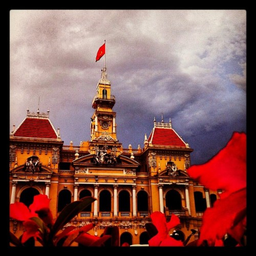 The People's Committee Building - Ho Chi Minh City, Vietnam (storm clouds looming in the distance… Impressive mix of architecture in this grand city!!) (at People's Committee - Nguyen Trung Ngan)