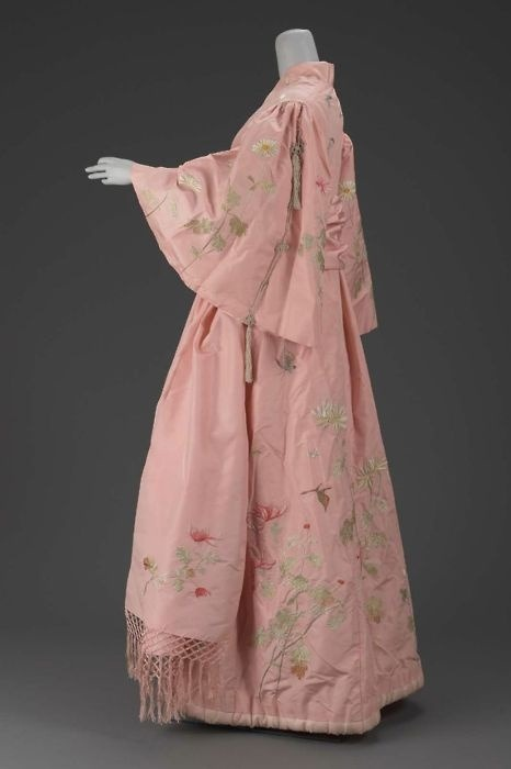 "Dressing Gown Iida Takashimaya, 1900 The Museum of Fine Arts, Boston: ""Pink silk taffeta dressing gown in kimono style with embroidered naturalistic chrysanthemums and butterflies in polychrome silks. Silk plain weave lining, padded hem and pleat in back of robe. Full sleeves gathered at shoulders and trimmed with braided silk cord and tassles. Matching sash of pink silk taffeta with double-sided embroidery of chrysanthemums in green brown and pink polychrome silk with knotted silk fringe. Gown labeled: S. Iida ""Takashimaya"" Silks and Embroideries. Kyoto."""