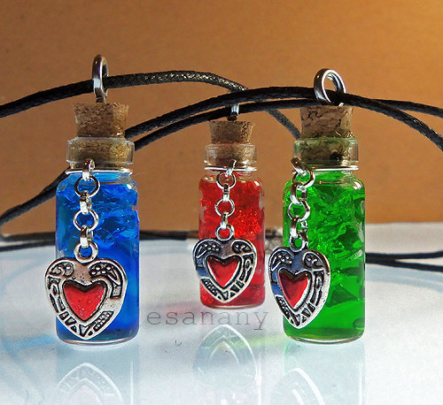 "Amazing Products - Zelda Potion Necklaces This amazing handmade necklace is based off of potions from the ""Legend of Zelda"" franchise. They have a rustic and magical touch and even feature heart pieces hanging from the top of the bottle. These necklaces are only available through EsaNany on Etsy. The pricing for this product is $10.98 (plus shipping) so hurry and buy one now. Image Source"