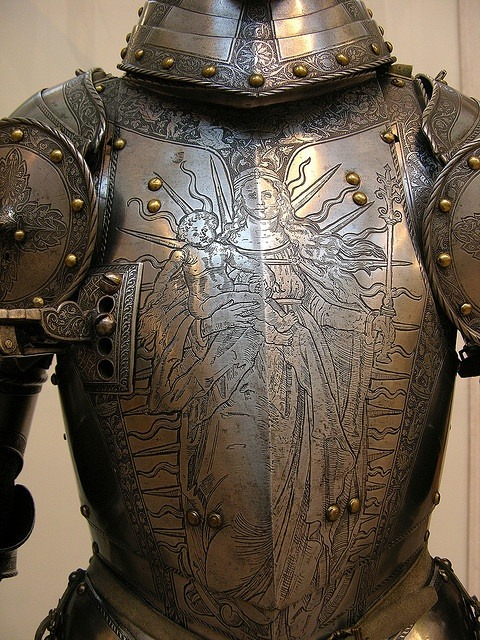 madamecuratrix:  Magnificent use of religious imagery on a suit of armor.