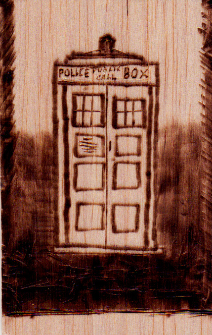 TARDIS - Doctor Who (Woodburning, Balsa wood) Just a practice run in woodburning (Creative expression for arsonists, yay!)It's a TARDIS, you know that, right? You know that!  It's like smaller than A5 and on cheap-as Balsa wood so I wasn't hoping for a work of art, but I like it and I'm keeping it 5eva :) (Also, hi there, Tumblr)