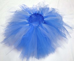 "Super POOFYTUTU - Blue Belle Tutu Handmade six layer tutu. Made in Canada with 100% Canadian garment grade tulle, elastic and ribbon. These tutus are lead free and conform to North American material safety standards for children's clothing.Super POOFYTUTUS are like two tutus in one… Lighter on one side than the other - just flip the tutu inside out for a darker tutu and back again for a lighter one.An elastic waistband gives at least 4"" of stretch, allowing plenty of room for growing - and makes them easy to pull on and off. The waistband is finished with a satin ribbon wrapping and tied with a bow.Super POOFYTUTUS are big, fluffy, and ready to prance around in straight out of the wrapping. Each one is unique and made with layers of the best quality tulle for an amazingly poofy tutu that will not let go of it's poof! Newborn - Girls size 9 $35.00CAD + shipping ORDER on Etsy ORDER via email money transfer: poofytutus@gmail.com POOFYTUTUS are perfect for parties, dress-up, dancing, photo shoots or rainy days."