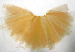 "Super POOFYTUTU - Miss Sunshine Tutu Handmade six layer tutu. Made in Canada with 100% Canadian garment grade tulle, elastic and ribbon. These tutus are lead free and conform to North American material safety standards for children's clothing.Super POOFYTUTUS are like two tutus in one… Lighter on one side than the other - just flip the tutu inside out for a darker tutu and back again for a lighter one.An elastic waistband gives at least 4"" of stretch, allowing plenty of room for growing - and makes them easy to pull on and off. The waistband is finished with a satin ribbon wrapping and tied with a bow.Super POOFYTUTUS are big, fluffy, and ready to prance around in straight out of the wrapping. Each one is unique and made with layers of the best quality tulle for an amazingly poofy tutu that will not let go of it's poof! Newborn - Girls size 9 $35.00CAD + shipping ORDER on Etsy ORDER via email money transfer: poofytutus@gmail.com POOFYTUTUS are perfect for parties, dress-up, dancing, photo shoots or rainy days."