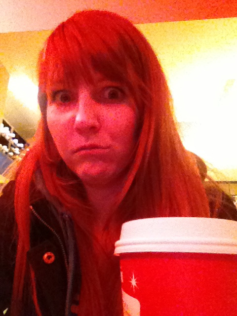At Starbucks, drinking a holiday themed coffee beverage, about to go Black Friday shopping before midnight on Thanksgiving. My face when I realize I'm that person.