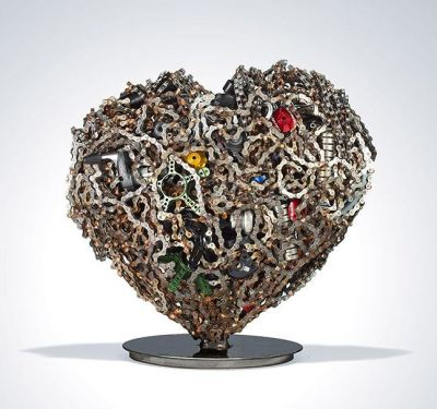 "Mark Castator ""Heart Lode""Materials: SRAM parts, used bicycle chains, silicon bronze  This year's pART Project – sponsored by SRAM, a Chicago-based bicycle-component company –  gathered 80 artists to undertake a quixotic task: assemble a vibrant artwork using a box of 100 parts like gears, chains and frame-related miscellany. The objets will be auctioned off on November 29 in New York City, with the proceeds going toward SRAM's World Bicycle Relief, an organization that has provided bikes and mechanical training to healthcare programs in Africa. It's kind of astonishing to see what somebody can conjure from what might as well be the leavings on a fix-it shop's floor.   More here: Incredible Sculptures Made From Bike Parts - Arts & Lifestyle - The Atlantic Cities"