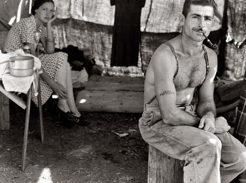 Unemployed lumber worker goes with his wife to the bean harvest. Note Social Security number tattooed on his arm, August, 1939.