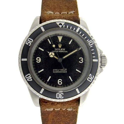 Vintage Rolex Submariner with a leather strap Juwelier Leopold www.Juwelier-Leopold.de
