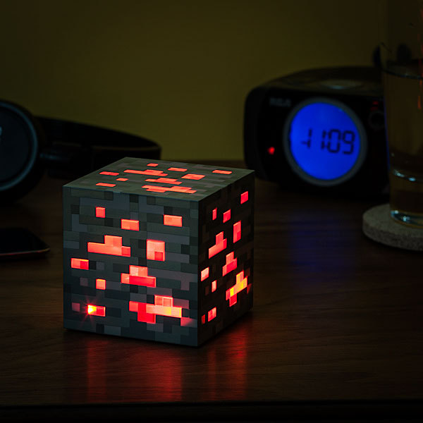 videogamenostalgia:  Minecraft Light-Up Redstone Ore available at Thinkgeek  Yes i want on right now