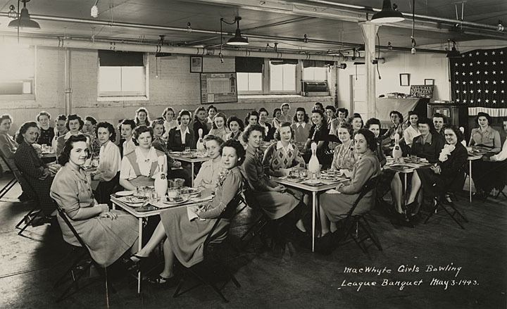 MacWhyte Girls Bowling League Banquet, Kenosha, Wisconsin, 1943. Female employees of the MacWhyte Company pose for a photograph. Check out the bowling pin centerpieces! via: Kenosha's Lost Industries, Kenosha County Historical Society by way of University of Wisconsin Digital Collections