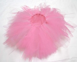 "Super POOFYTUTU - Powderpoof Tutu Handmade six layer tutu. Made in Canada with 100% Canadian garment grade tulle, elastic and ribbon. These tutus are lead free and conform to North American material safety standards for children's clothing.Super POOFYTUTUS are like two tutus in one… Lighter on one side than the other - just flip the tutu inside out for a darker tutu and back again for a lighter one.An elastic waistband gives at least 4"" of stretch, allowing plenty of room for growing - and makes them easy to pull on and off. The waistband is finished with a satin ribbon wrapping and tied with a bow.Super POOFYTUTUS are big, fluffy, and ready to prance around in straight out of the wrapping. Each one is unique and made with layers of the best quality tulle for an amazingly poofy tutu that will not let go of it's poof! $35.00CAD + shipping ORDER on Etsy ORDER via email money transfer: poofytutus@gmail.com POOFYTUTUS are perfect for parties, dress-up, dancing, photo shoots or rainy days."