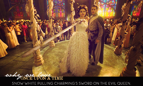 Snow White pulling Charming's sword on the Evil Queen.