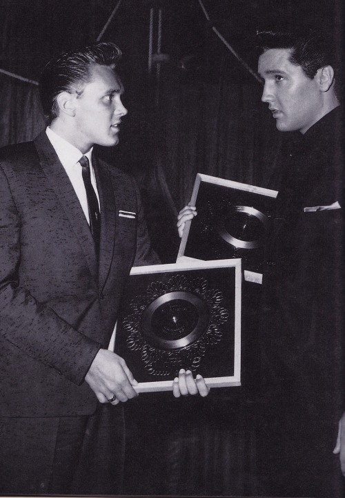 Britain's Billy Fury presents silver disc awards to Elvis on the set of 'Girls! Girls! Girls!', 1962.