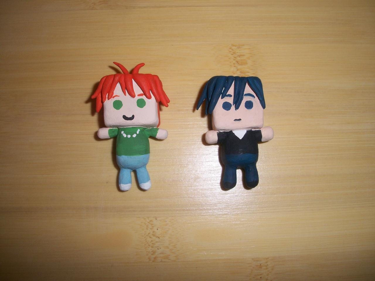 pumpkinninja:  Off*Beat chibi charms, first attempt third batch. (Colin: Second attempt.) I had original, when sketching out a plan for the charms, thought that Tory would be difficult to make. Turns out Colin was the hardest. My first attempt was a disaster and didn't look anything like him. I sure hope this one looks like him. I think it does…but then again, I'm looking at them threw rose colored glasses! CX Tory- Height: 2 inches, Width: 1 inch. Colin- Height: 1 inch and a half, Width: 1 inch.  They were made from oven baked clay and painted with acrylic paint. Anyways, I was super excited to make these. Off*Beat is such a cute story. Tory and Colin are from Off*Beat, a graphic novel by Jen Lee Quick. You can visit her on her DA page: http://wulfmune.deviantart.com/ Or you can visit her and see her online comic here: http://witchsquarry.smackjeeves.com/  doh, they are so cute!!  thank you for showing off*beat some lovin'~