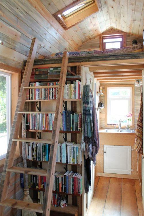 ayabug:  hlmp:  worthsaving:  April Anson's Tiny Home  One of the best tiny trailer houses I've seen…  Tiny plus boooooooooooks. Yes!
