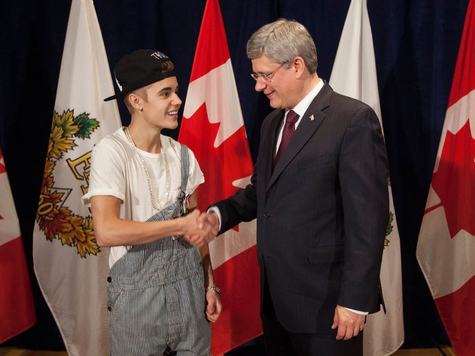 Justin Bieber met Prime Minister Stephen Harper today, to receive a Diamond Jubilee Medal. What do you think they're thinking in this photo? (PM Stephen Harper's Photostream/Flickr)