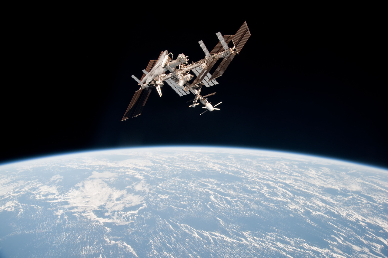 for-all-mankind:  Another one of my favourite space images - the ISS high above the Earth, as seen from a Soyuz on the final Space Shuttle Mission. [Edit, I don;t know how I got the two craft mixed up. Must be one of those days.]