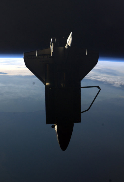 for-all-mankind:  Atlantis as seen from the ISS, 19 July 2011. Backing away from the station for the final time, the Shuttle is hidden in Earth's Shadow.