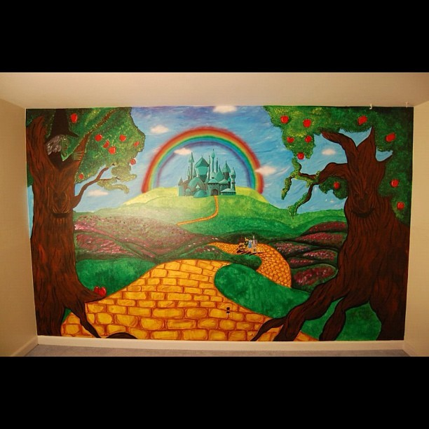 Wall to wall, floor to ceiling, full wall mural done by me! #wizardofoz #oz #paint #acrylic #acrylicpaint #colors #mural #babyroom #nursery #baby #carascreations #decor #focalpoint #home #homedecor #art #artdesign #design #emerldcity #apple #appletree #wickedeitch #dorothy #rubyslippers #scarecrow #tinman #lion #rainbow #yellowbrickroad #flowers