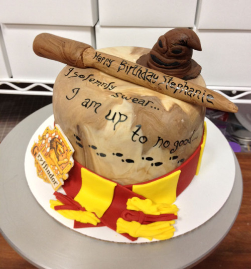 Harry Potter-themed cakes are some of our favorites to make, and this one might have been the most fun yet. The cake is fondant covered and hand-painted to look like the Marauders' Map. Around the base of the cake is a Gryffindor scarf and crest (customer's choice! we can do other houses!), and the cake is topped with a hand-sculpted fondant wand and sorting hat.