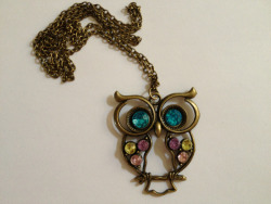 byelesbian:  kirashopbye:  ITEM #2 This is a vintage bronze owl necklace with colorful jewels. $8.50 (free shipping in US) Originally $10.00 with shipping from Etsy  I lowered the price down to $7.00 for today :) If you buy something from me I will follow you. You can purchase this here.