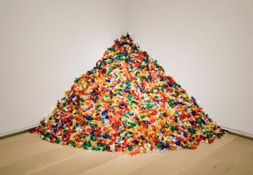 "museumuesum:   Felix Gonzalez-Torres ""Untitled"" (Portrait of Ross in L.A.), 1991 Multicolored candies, individually wrapped in cellophane Ideal weight 175 lb; installed dimensions variable, approximately 92 x 92 x 92 cm (36 x 36 x 36 in.) Felix Gonzalez-Torres produced work of uncompromising beauty and simplicity, transforming the everyday into profound meditations on love and loss. ""Untitled"" (Portrait of Ross in L.A.) is an allegorical representation of the artist's partner, Ross Laycock, who died of an AIDS-related illness in 1991. The installation is comprised of 175 pounds of candy, corresponding to Ross's ideal body weight. Viewers are encouraged to take a piece of candy, and the diminishing amount parallels Ross's weight loss and suffering prior to his death. Gonzalez-Torres stipulated that the pile should be continuously replenished, thus metaphorically granting perpetual life."
