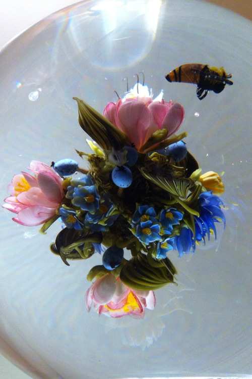 tremblebot:  Detail of a Paul Stankard piece Berkshire Bouquet Orb with Honeybee that is one of the most beautiful pieces of art I've ever seen up close. Shot somewhere in Westernmost Massachusetts at the very end of an absolute dream this weekend, 2012. There are lots of things to be thankful for and it never feels enough but I'm thankful for honeybees suspended in glass orbs, floating above blueberries and pink petals while snow falls quickly outside.