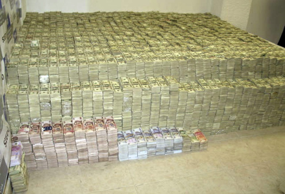 drugwar:  A haul of about 206 million U.S. dollars is seen after it was found stashed in closets, suitcases, and drawers in a house in an upscale neighborhood of Mexico City March 15, 2007. Law enforcement officials said the money belonged to drugs smugglers who imported chemicals used to make methamphetamine. Seven people were arrested in the raid.