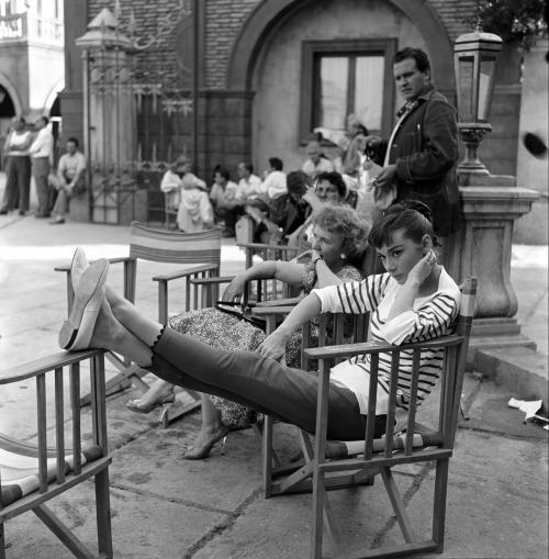 rareaudreyhepburn:  Audrey Hepburn photographed relaxing on the set of War and Peace, 1955.