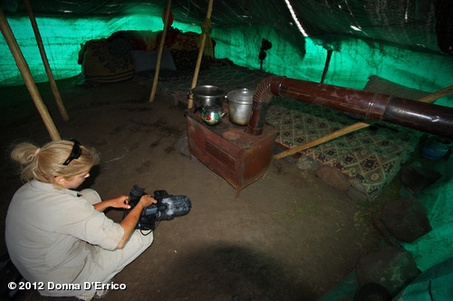 August 2012 Mt. Ararat Expedition: Inside a typical Kurdish tent on the slopes of Mt. Ararat. Families cook, eat, and sleep in tents like these. The bedding-like area along the back wall doubles as seating during the day. They are kept very tidy inside by the women. View more Donna D'Errico on WhoSay